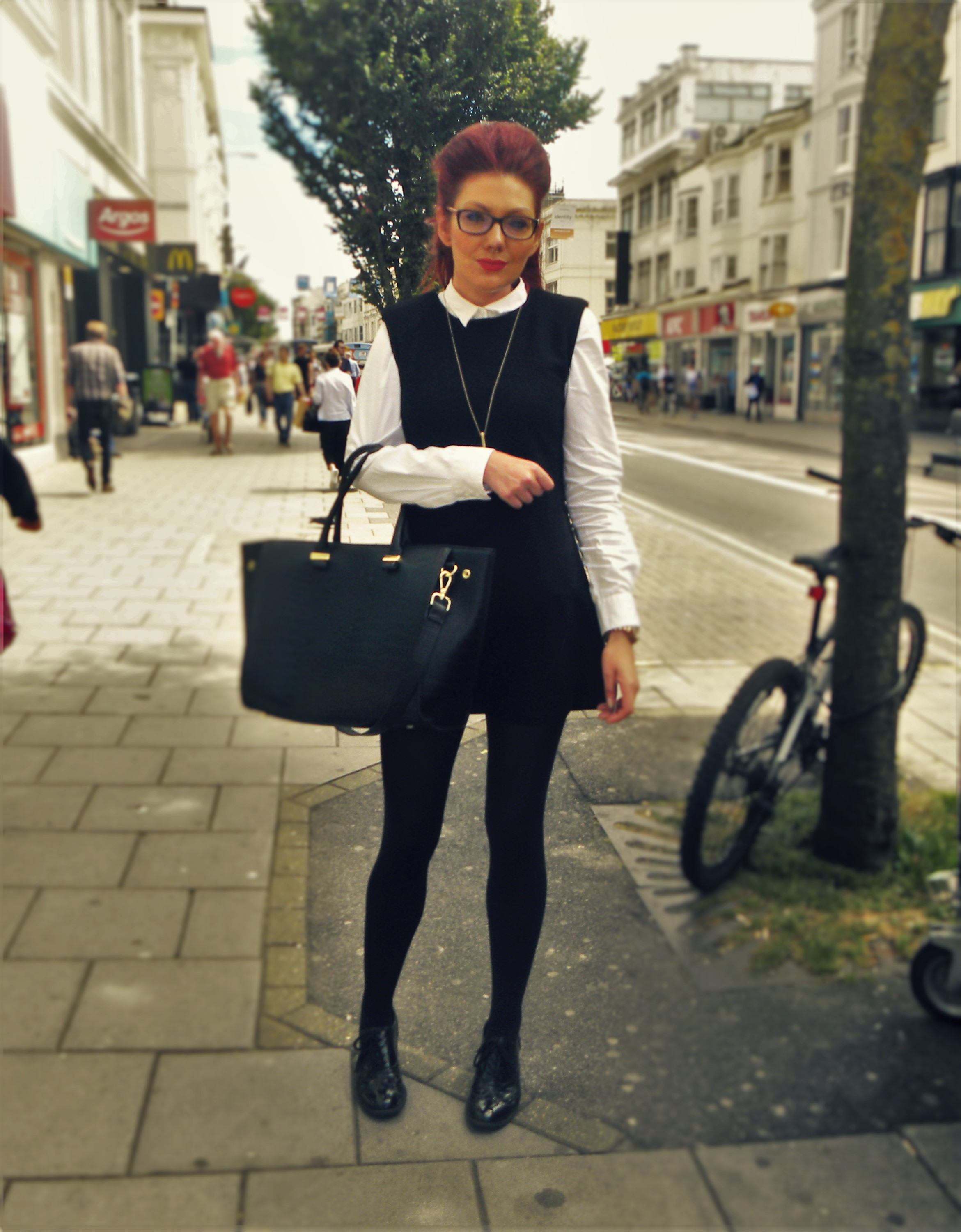 Antonia is wearing a shirt from Next, this classic black dress from New Look, bag and shoes also from New Look.