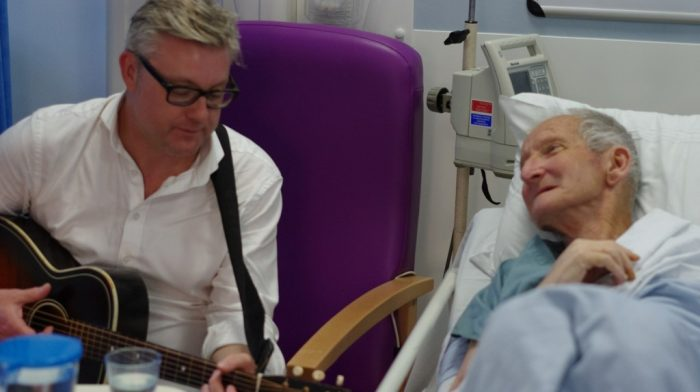 Russ Callaghan with a patient
