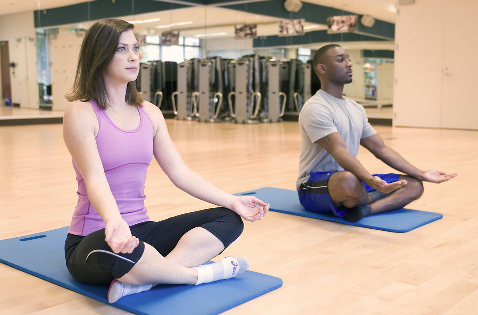 15407-a-man-and-woman-practicing-yoga-in-a-fitness-center-pv