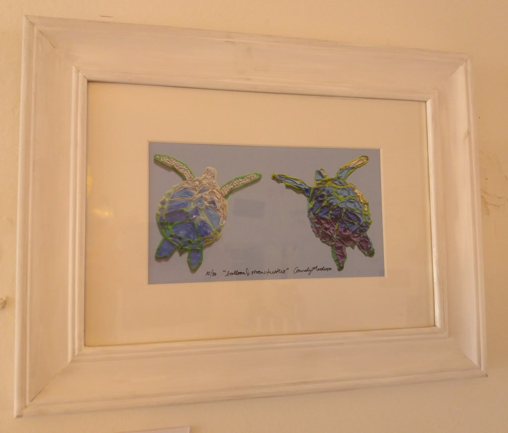 A framed print of her plastic turtles.