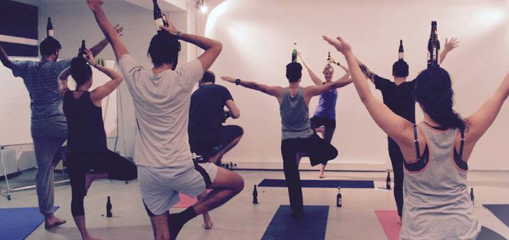 Surprisingly, all the participants in her beer yoga trial classes managed to balance the beer bottles on their head. Photo via Facebook.