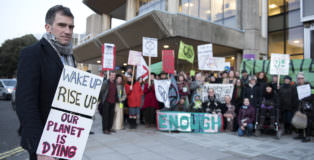 Green Couuncillor Ollie Sykes protesting with Extinction Rebellion campaigners and members of the Green Group